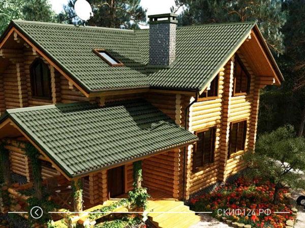 Большой дом из дерева с зеленой крышей из черепицы Ондулин