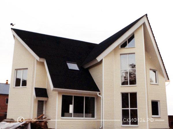 Внешний вид ондулина СМАРТ на крыше дома черного цвета