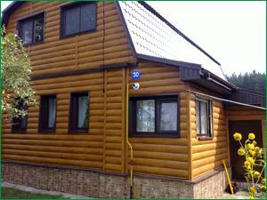 Фото дома из металлического сайдинга с имитацией бруса